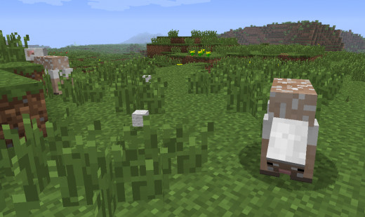 A shorn minecraft sheep eating grass.