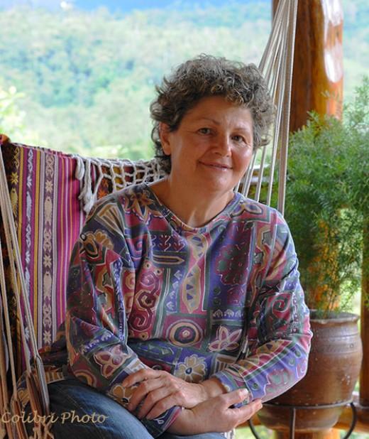 Maria Elena Garzon Jaramillo on the porch of the Hacienda San Vicente