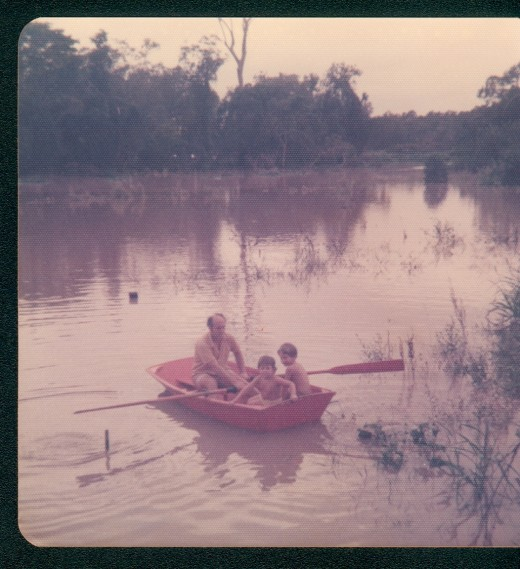 My dad Rowing my sister & myself in the 1974 flood