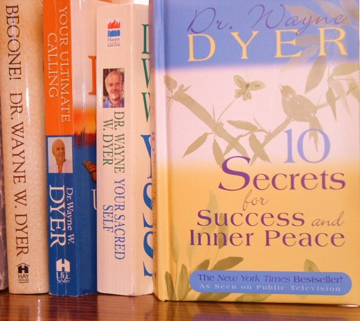 Photo of some of the books I own that were authored by Dr. Wayne Dyer.