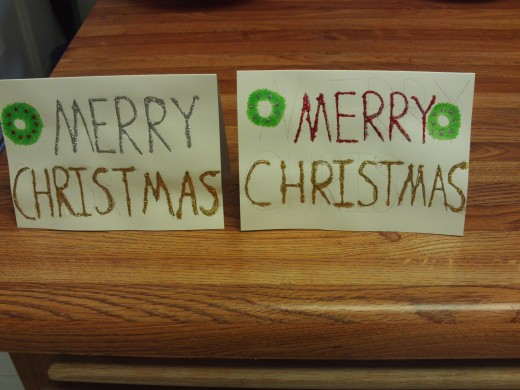 Two glittery Christmas cards that I made with glitter glue.