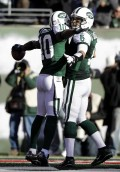 New York Jets' Santonio Holmes, left, celebrates his touchdown with quarterback Mark Sanchez during the second quarter of the NFL football game against the Kansas City Chiefs, Sunday, Dec. 11, 2011, in East Rutherford, N.J. (AP Photo/Kathy Willens)