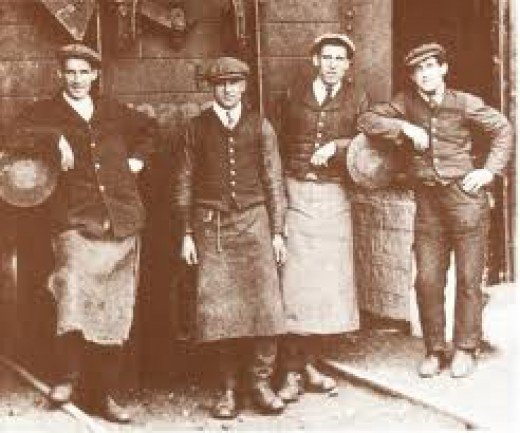 Early days, porters at Wymondham (pron. 'Windam') in Norfolk, East Anglia await customers. Later years would not be kind to rural railways, many stations around the country becoming no more than unstaffed halts