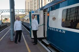 Blue Pullman attendants await custom. This is 'The Age of the Train' as BR liked to tell us. The Blue Pullmans were nicknamed 'The Expense Account Trains', the preferred mode of travel for businessmen