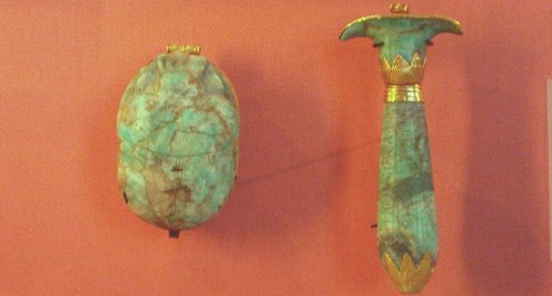 Ancient Egyptian amulets..a scarab and papyrus