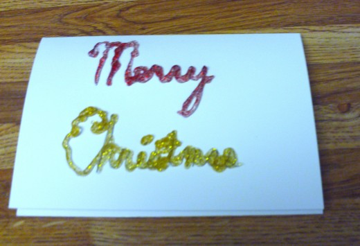 "Here I traced over the ""Christmas"" text with the gold glitter glue."