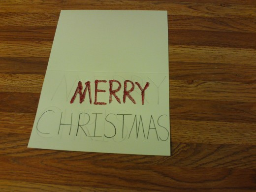 "I traced the word ""Merry"" with the red glitter glue."
