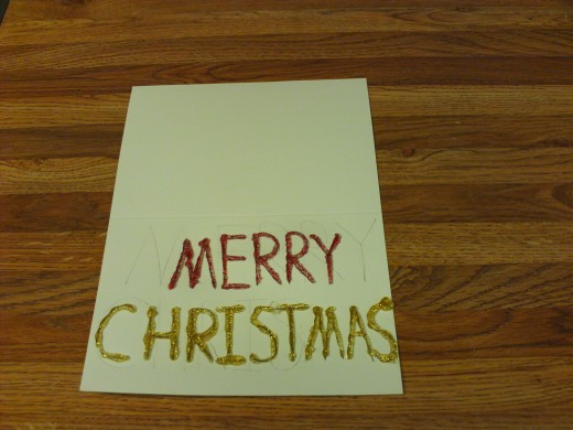"The ""Christmas"" text was traced over with gold glitter glue."