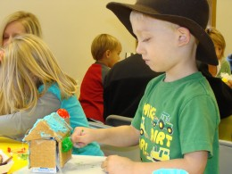 Making a graham cracker Christmas House takes great concentration