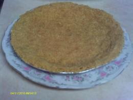 Pat the graham cracker mixture into the pie pan.