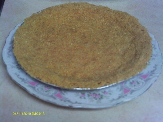 Pat the graham cracker mixture into the pie pan.