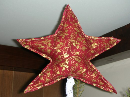 Star-shaped Christmas tree topper