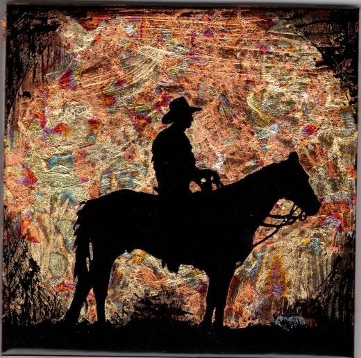 Reverse gilded cowboy on black ceramic tile