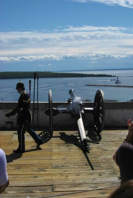 Firing a canon at Fort Mackinac