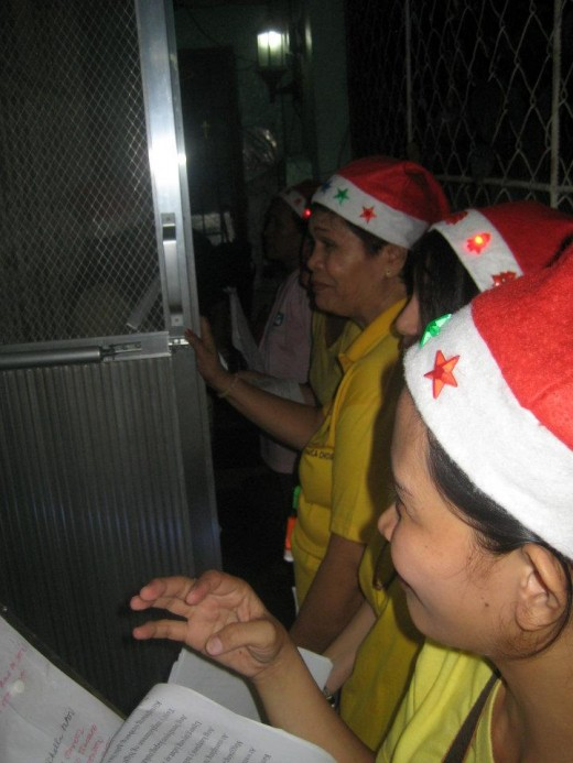 Carolers knocking at the gate err door of the house (Photo by Travel Man)
