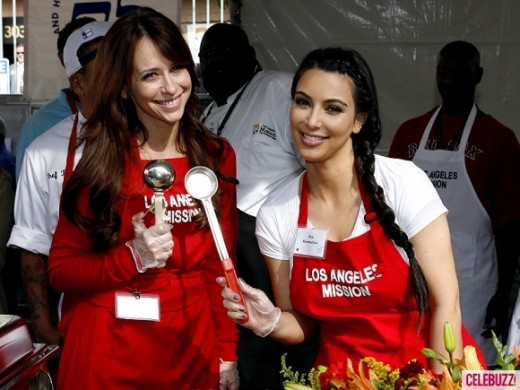 JENNIFER LOVE HEWITT, BEING THE HUMBLE, CARING GIRL THAT SHE IS, TOOK TIME OUT TO POSE WITH A JEALOUS KIM KARDASHIAN WHO WAS WORKING FOR SOME CALIFORNIA CHARITY IN THE RESTAURANT.