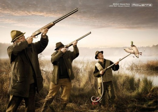 "GUNS OR VACUUM CLEANERS? OR WAS THE AD SAYING, ""MR. HUNTER, IF YOU DON'T USE OUR SHOTGUN, YOU ARE JUST 'SUCKING AIR.'"