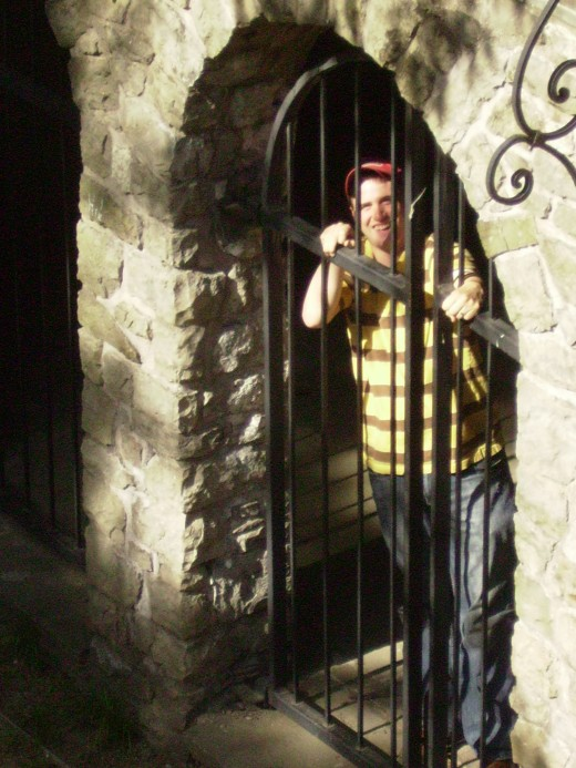 My nephew pretending to be locked in a dungeon