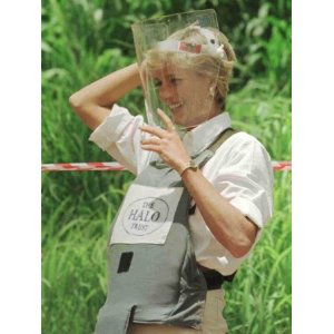 Princess Diana Adjusts Her Face Protector During Her Visit to Mine Fields in Haumbo Angola