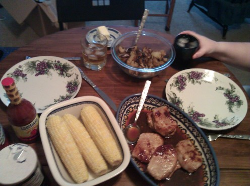One of our first gluten-free dinners: roasted corn, pork chops with homemade sweet-and-sour sauce, and home fries.