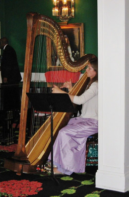 A harpist entertaining guest during Afternoon Tea at the Grand Hotel.