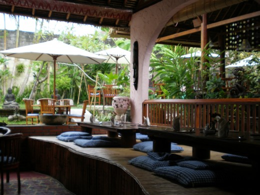 One of Ubud's chilled-out restaurants with its pleasant tropical garden. Bali, Indonesia.