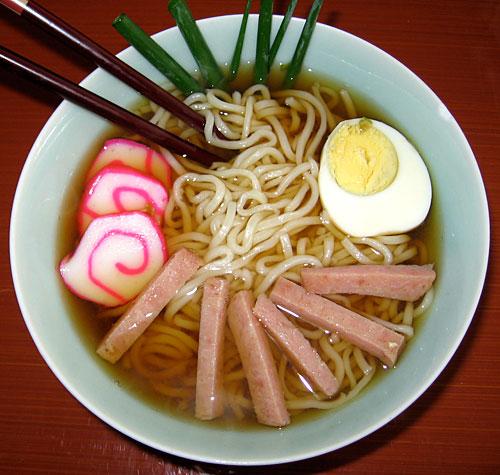 Saimin garnished with kamaboko (Japanese fish cake), spam, green onions and egg