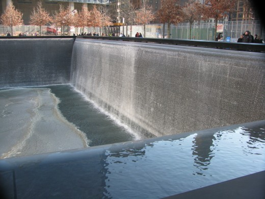 A view of one side of one of the Reflecting Pool's waterfall.