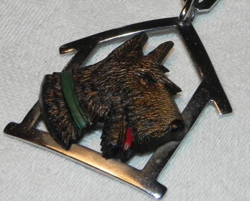Charles Homer vintage Art Deco Scottie dog brooch in bakelite and metal.