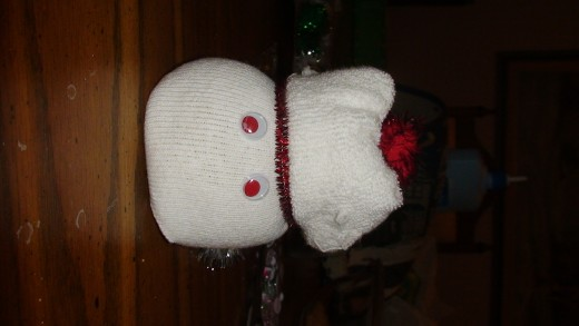 Step 6 and 7:  Googly Eyes and Pom pom on hat.