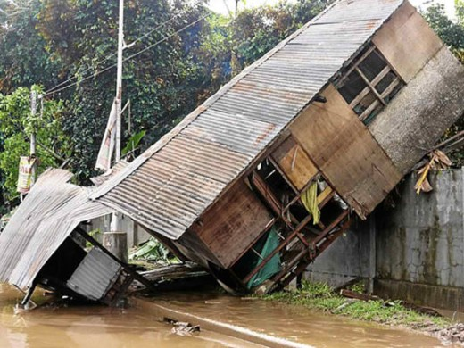 This house was seen resting on a wall after typhoon Sendong hit the entire area.