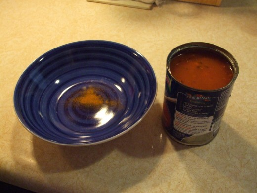 Turmeric powder at bottom of soup bowl.  Can of healthy soup will cover it.