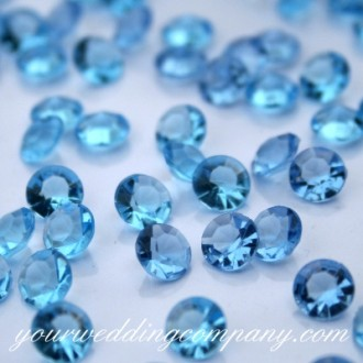 Scatter diamond confetti around centerpieces for added sparkle and color.