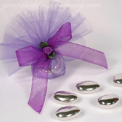 Five silver almonds are wrapped in purple tulle circles and decorated with ribbon and a ribbon rose accent.
