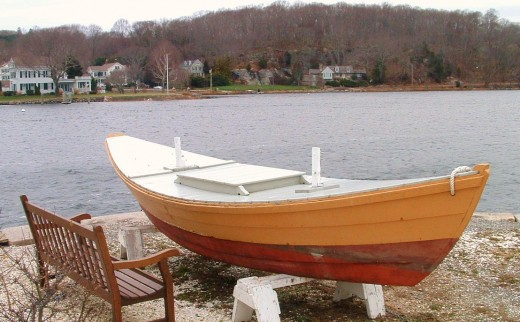 Photo of a beautifully restored wooden boat.