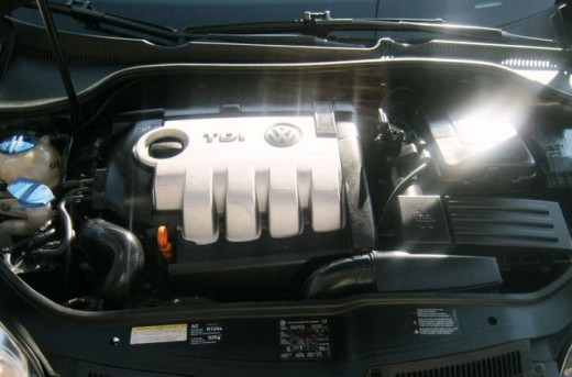 Remove the cover to the engine, if needed.