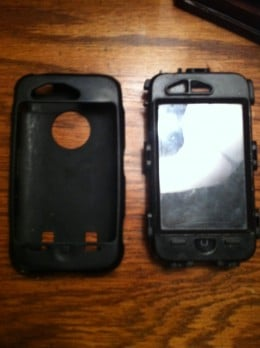 The OtterBox Defender's silicone shell sitting next to the OtterBox Defender.