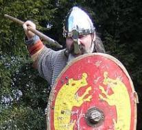 Viking spearman with dished shield  bearing images of fighting boars