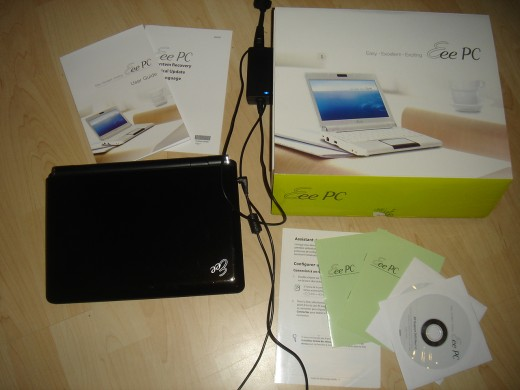 The netbook with box, manual and recovery disc.