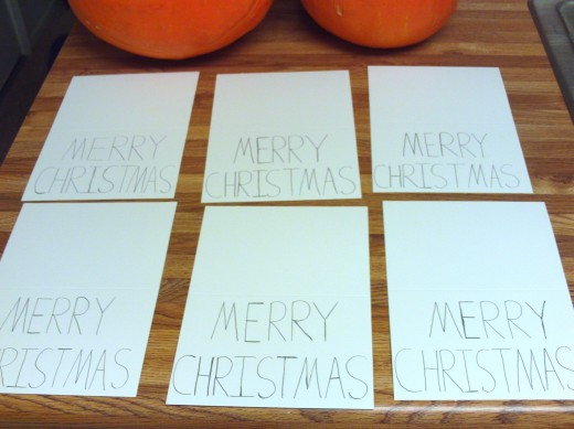 Start an assembly line with blank cards to write Merry Christmas on.