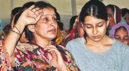 Example of News Photograph. The mother of a martyr saluting her only son on his funeral.