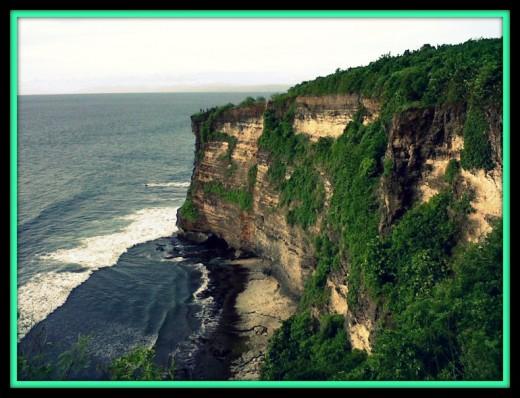 Beach, Ocean and High Cliff at Uluwatu.