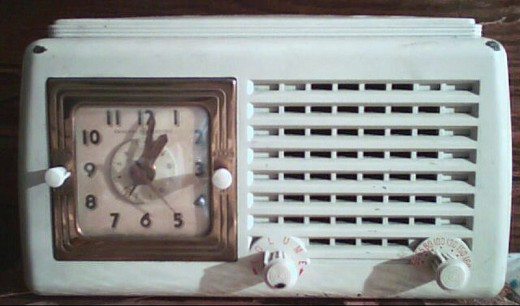 An old electric clock, with radio integrated in it. Electric clocks are now mostly replaced by battery operated quartz clocks.