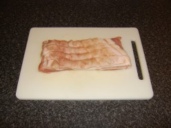 Score the skin side of the belly pork