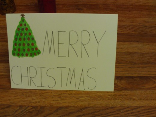 Here I drew a solitary Christmas tree on the front of the card.