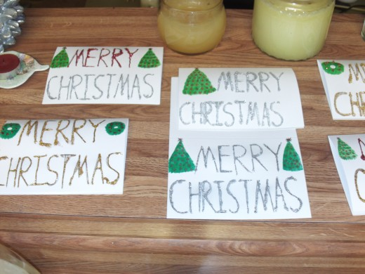 Christmas trees and wreaths are simple decorations you can make for glitter glue cards.