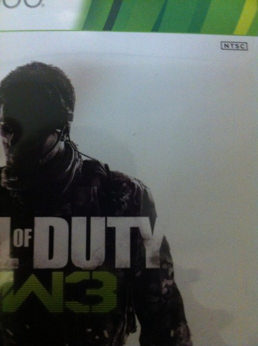 The region code icon is often on the front cover of games. For example, in this image from Call of Duty: Modern Warfare 3, the NTSC logo is in the upper-right corner.