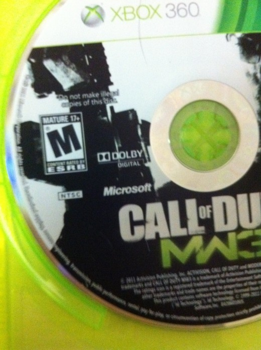 The region code is listed on most discs. For example, in this picture of the COD: Modern Warfare 3 discs, the NTSC region code appears beneath the ESRB rating.