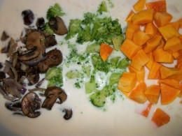 Add sauteed mushrooms, broccoli, and butternut squash to soup mixture