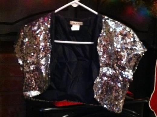 Here's the vest I bought, covered in sequins and already lined it was perfect to turn into a little bag.